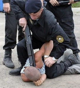 Like their SWAT counterparts in the United States, Russia's OMON are known for their commando tactics. Vostok forum participants were held on the ground at gunpoint much like this poor chap I found using Google's image search. (File photo).